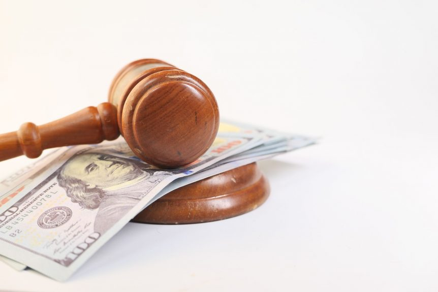 gavel on top of cash representing the child support modification payment