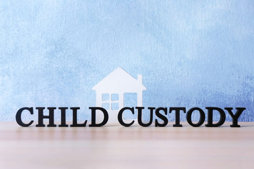 child custody concept and home behind it
