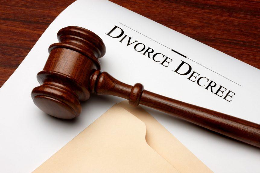 filing for divorce decree papers under gavel