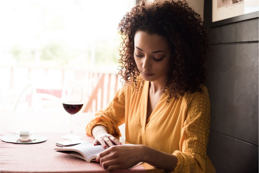 women reading self help book to overcome her divorce